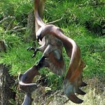 Bronze Sculpture of Osprey catching salmon